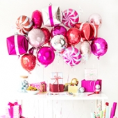 A Goodies + Gift Wrap Holiday Party (+ DIY Present Balloons!)